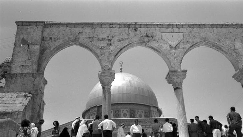 BEFORE: Palestinians stand in front of the Dome of the Rock on the compound known to Muslims as Noble Sanctuary and to Jews as Temple Mount. (Reuters)