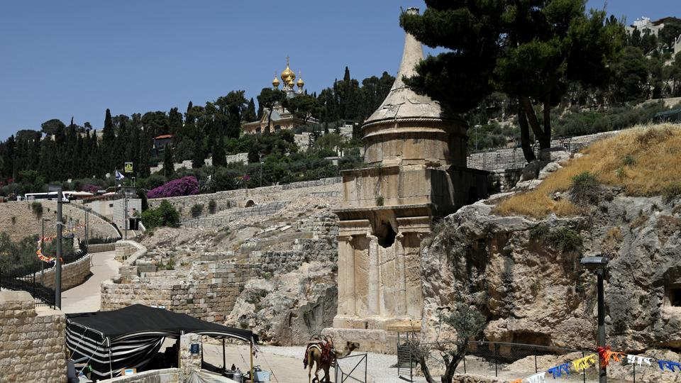 AFTER: : Avshalom's tomb and the Garden of Gethsemane are seen in Jerusalem . Both stand on an elevated plaza Jews refer to as Temple Mount, the holiest site in Judaism, and the location of an ancient Jewish temple. (Ronen Zvulun  / REUTERS)