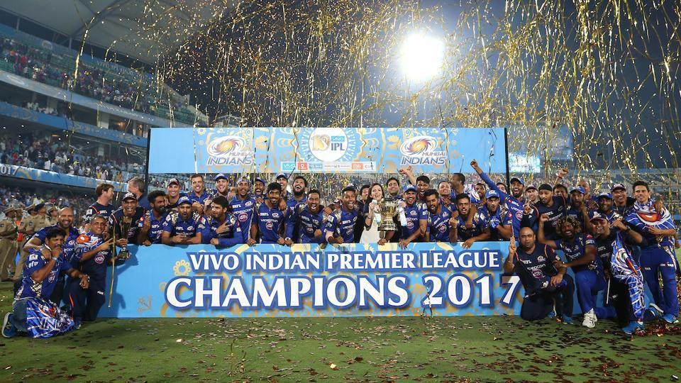 Mumbai Indians (MI) players and team management pose with the IPL trophy after winning the final against Rising Pune Supergiant. (BCCI)