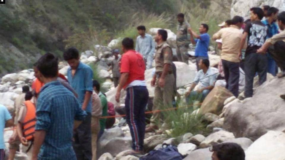 Rescue personnel and locals during the search operation after the accident in Uttarkashmi.