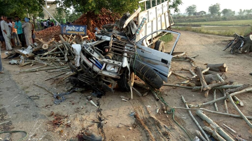 Mangled remains of the timber-laden pickup van at the accident spot near Hoshiarpur.