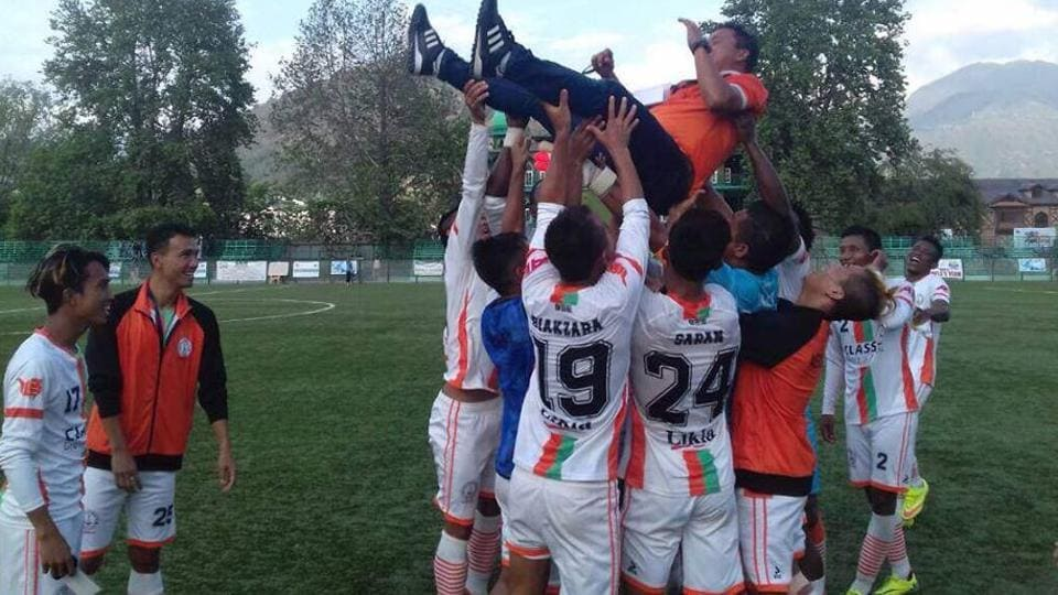 Neroca FC players celebrate after winning the 2nd Division League title.