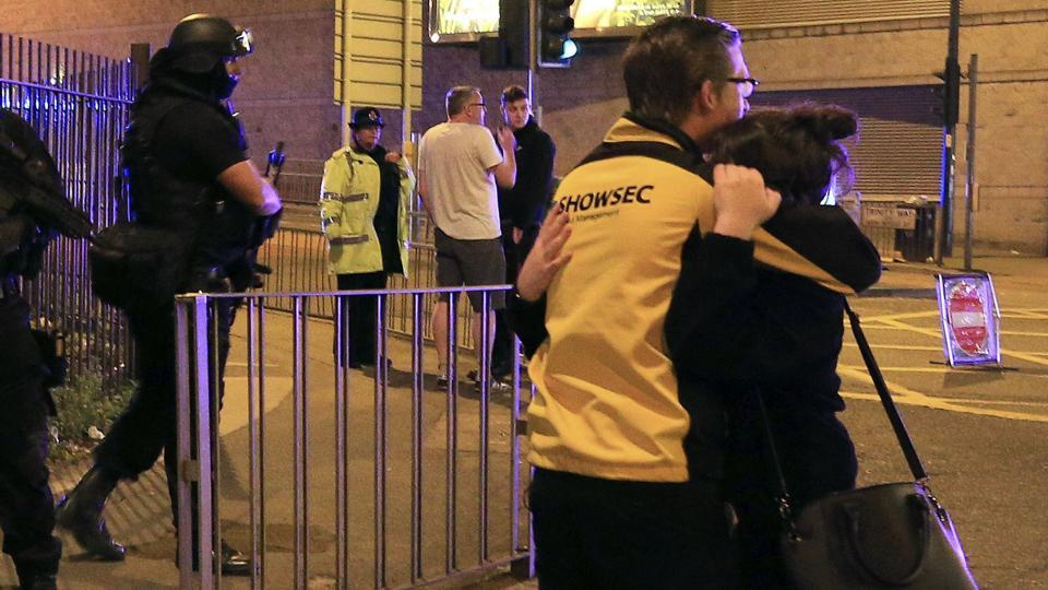 Armed police stand guard at Manchester Arena after reports of an explosion at the venue during an Ariana Grande gig in Manchester, England.