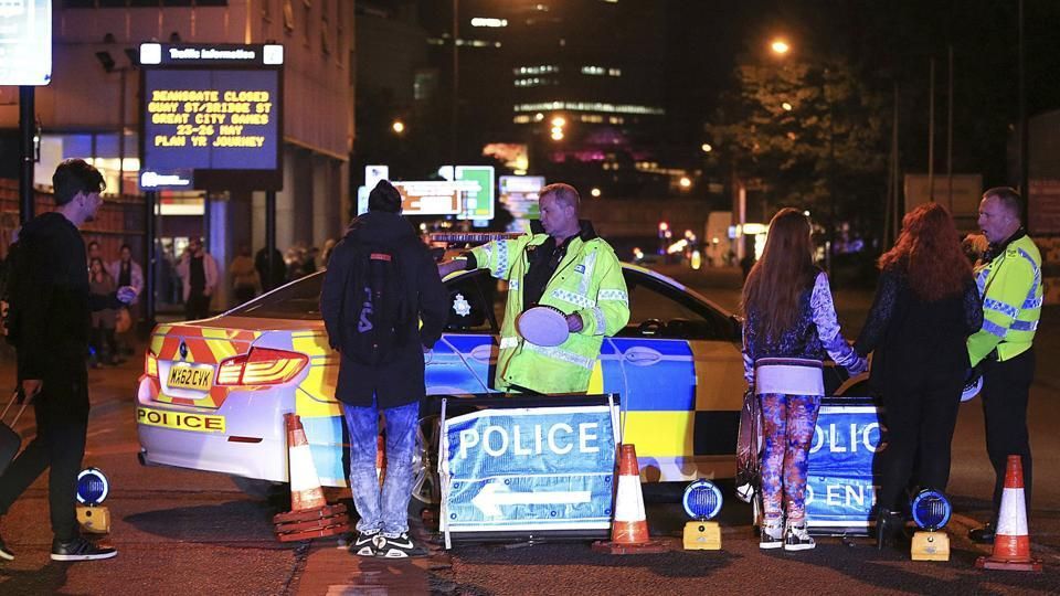 Emergency services work at Manchester Arena after reports of an explosion at the venue during an Ariana Grande gig in Manchester.