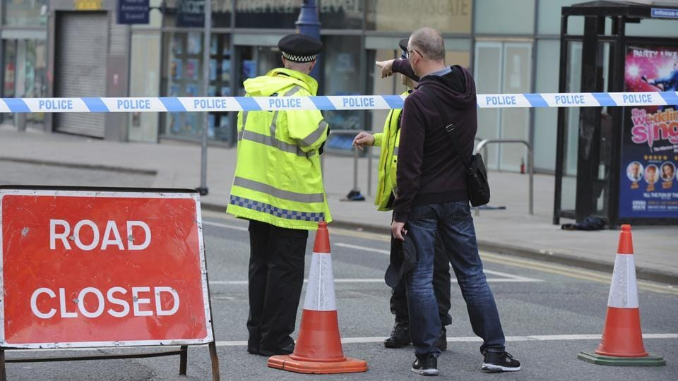 Police block a road near to the Manchester Arena in central Manchester, England.