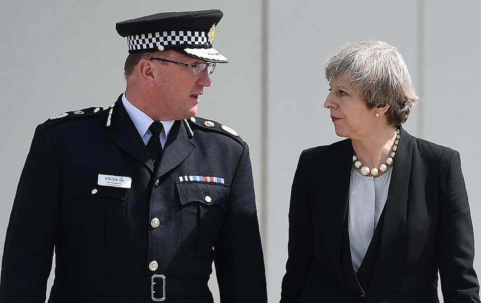 Britain's Prime Minister Theresa May (R) walks with chief constable of Greater Manchester Police, Ian Hopkins as she leaves following their meeting at the police force's headquarters in Manchester, northwest England on May 23, 2017.  (Oli SCARFF/AFP)