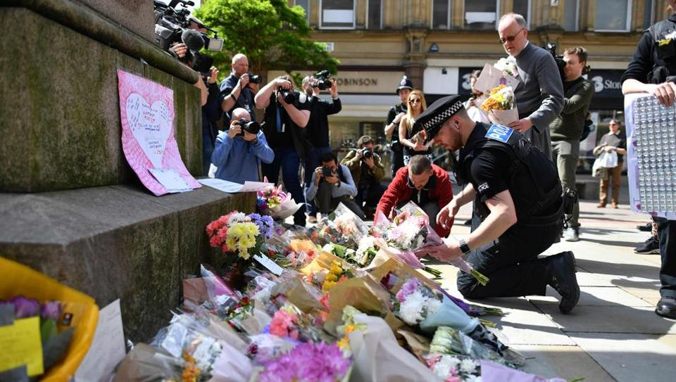 Floral tributes offered in St Ann's Square in Manchester as a mark of respect to those killed and injured following a deadly terror attack at the Manchester Arena.