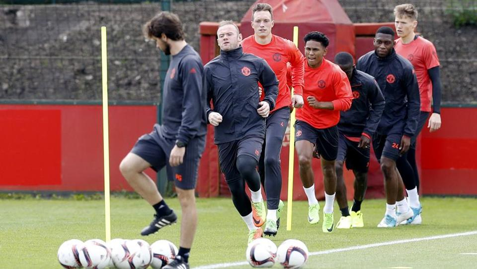 Manchester United's Wayne Rooney, second left, attends a training session ahead of their Europa League final against Ajax.