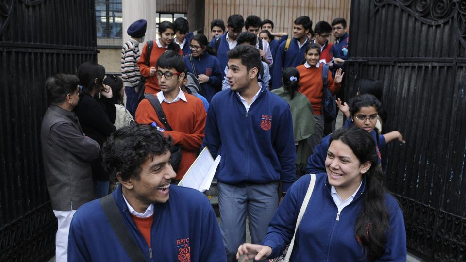 Students coming out after taking the CBSE board Class 12 exam at Guru Harkishan Public School in New Delhi.