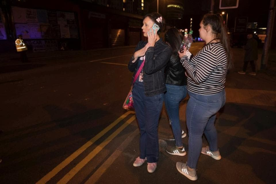 Concert goers react after fleeing the Manchester Arena in northern England where U.S. singer Ariana Grande had been performing in Manchester, Britain, May 22, 2017. (John Super/REUTERS)