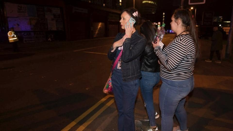 Concert goers react after fleeing the Manchester Arena in northern England where US singer Ariana Grande had been performing in Manchester, Britain, May 22.