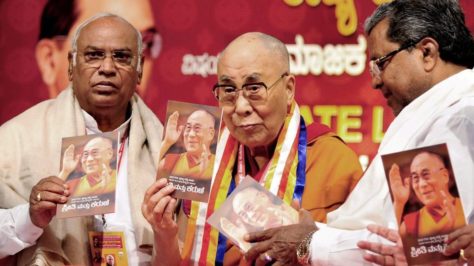 Tibetan spiritual leader the Dalai Lama with Karnataka Chief Minister Siddaramaiah and Congress MP Mallikarjun Kharge during a seminar on 'Social Justice and B R Ambedkar', in Bengaluru on Tuesday.