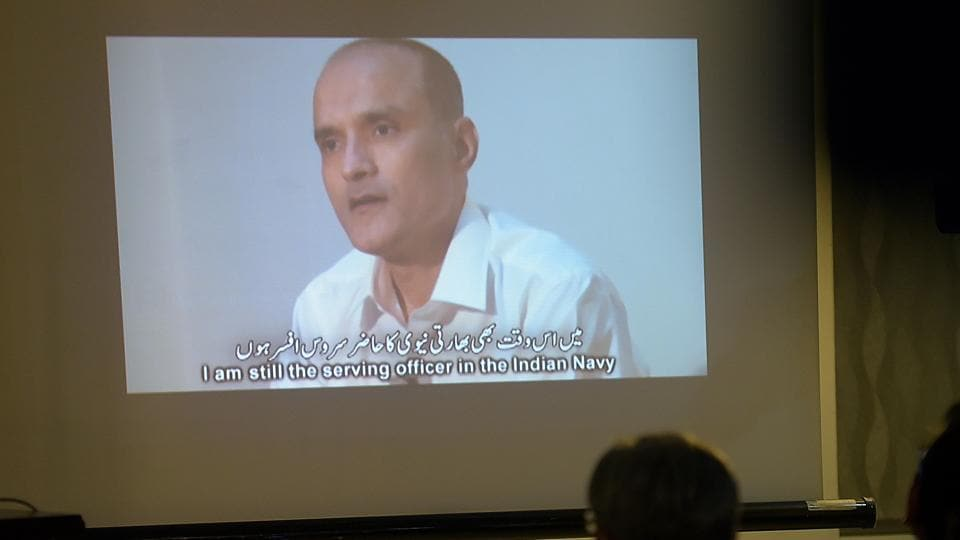 This file photo shows Pakistani journalists watching a video showing Indian national Kulbhushan Yadav, arrested on suspicion of spying, during a press conference in Islamabad.