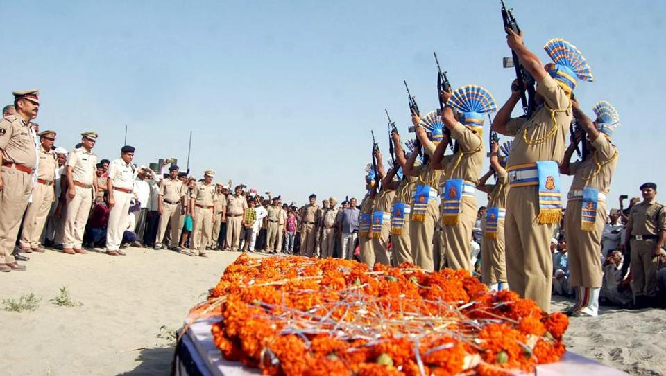 CRPF personnel give the gun salute to a trooper killed in the Sukma attack.