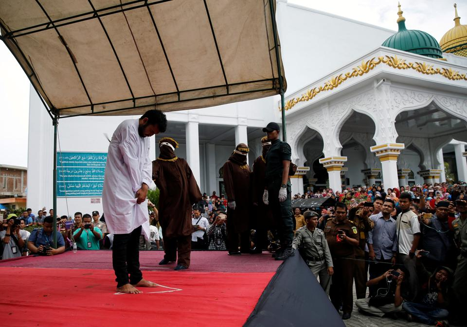 An Indonesian man is publicly caned for having gay sex, in Banda Aceh, Aceh province, Indonesia.