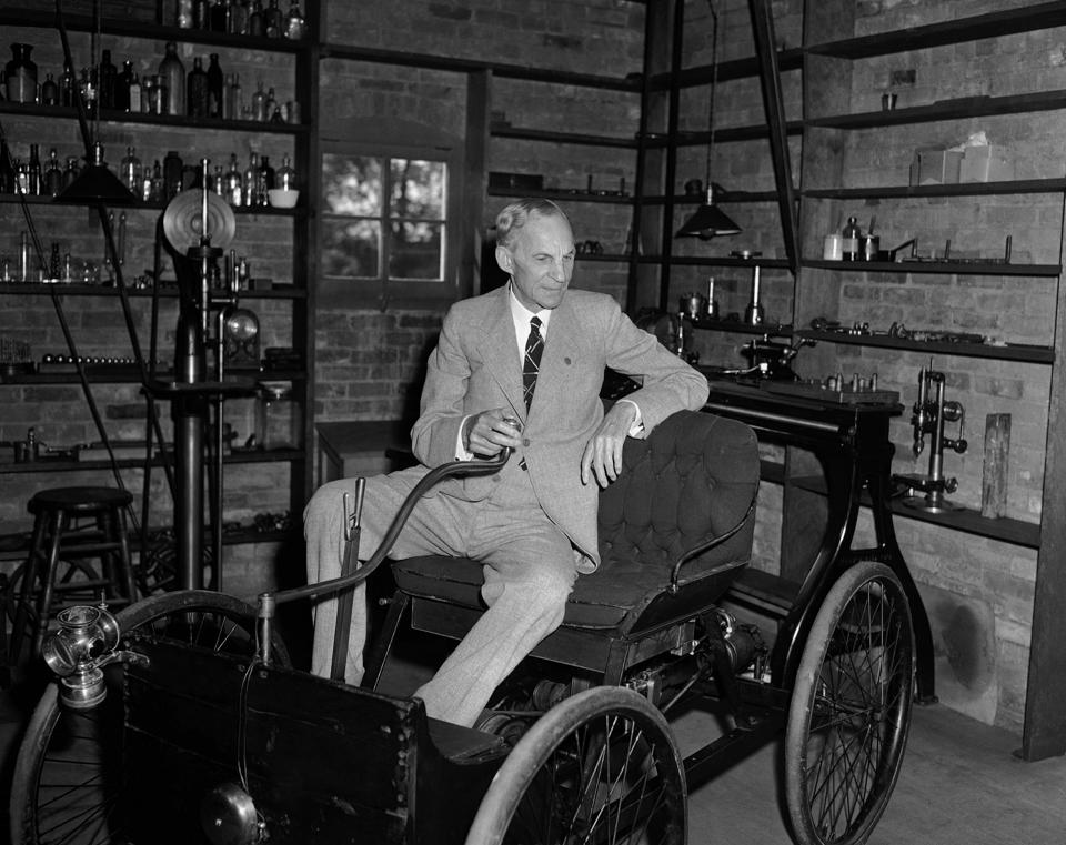 In this July 30, 1942, file photo, Henry Ford visits the shop in Detroit where he built his first auto.