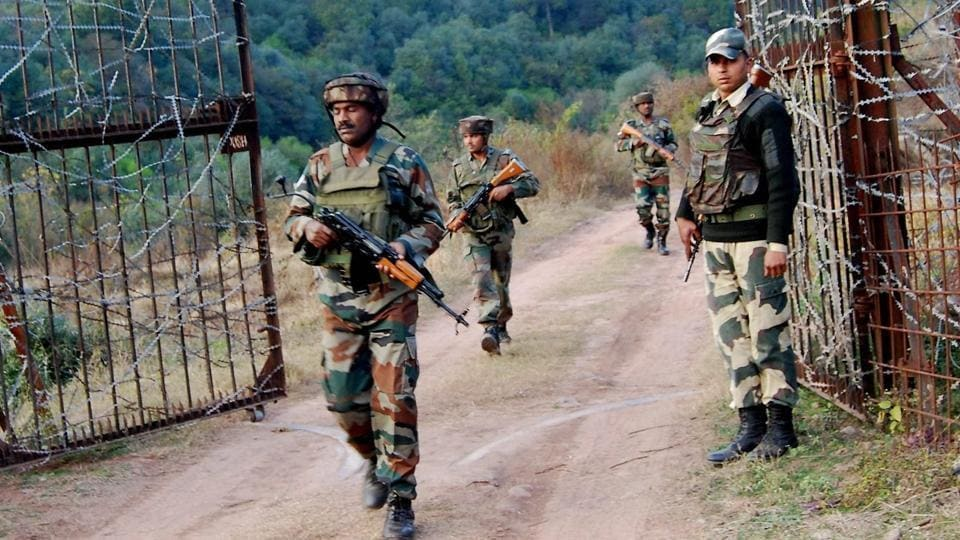 Soldiers take position near the Line of Control (LoC) in Poonch after cross-border shelling from Pakistan left two civilians dead and three injured in Naushera sector in Rajouri district on Saturday.