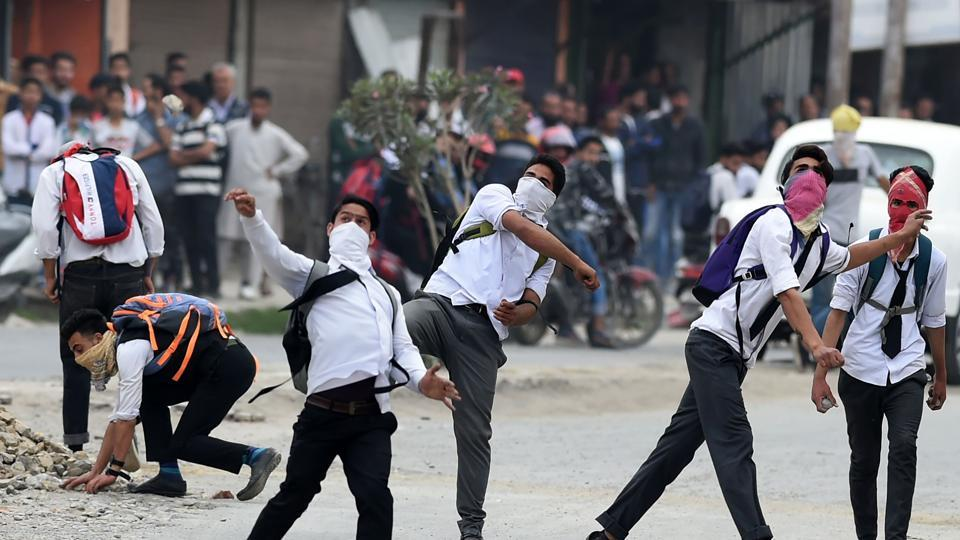 File photo of Kashmiri students throw ing stones during clashes with security  forces in Srinagar. On Tuesday, students in Pulwama protesting the arrest of stone pelters clashed with police in the town.