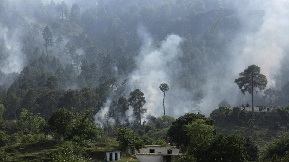 Smoke rises from a mortar shell in Naushera sector in Kashmir.
