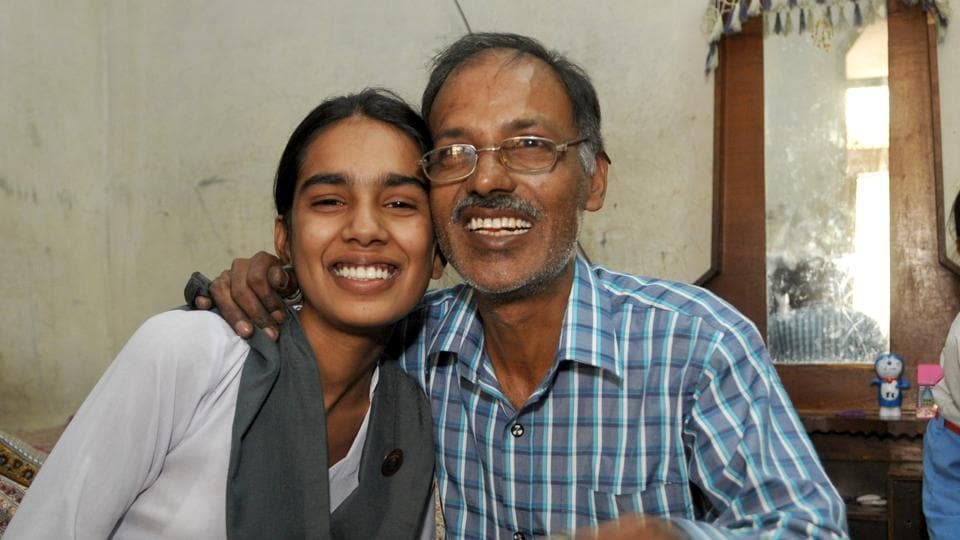 Jalandhar's Jyoti Mahey, who topped the district with 97.23% marks, with her father.