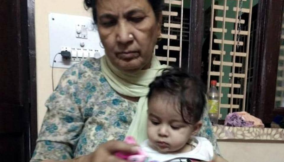 Eight-month-old Shivika with her grandmother at home in Ludhiana on Saturday.
