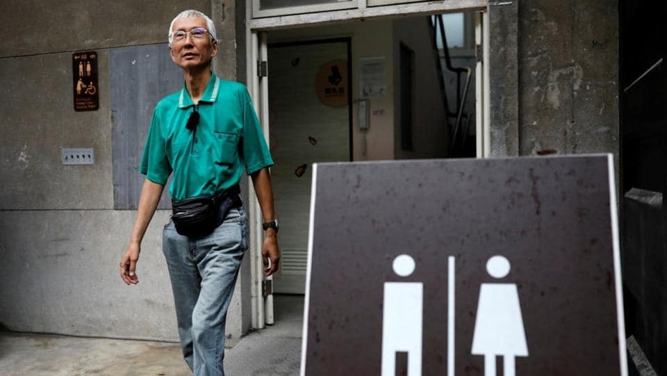 Chi Chia-wei,  a gay rights activist, leaves a bathroom in Taipei, Taiwan. As of January 2017, same-sex couples in Taiwan could legally register their partnerships in some of the cities in Taiwan. However the rights afforded in these partnerships were very limited.  (Tyrone Siu/REUTERS )