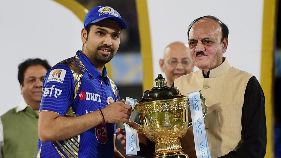 Mumbai Indians captain Rohit sharma receives the IPL 2017 trophy after their victory over Rising Pune Supergiant.