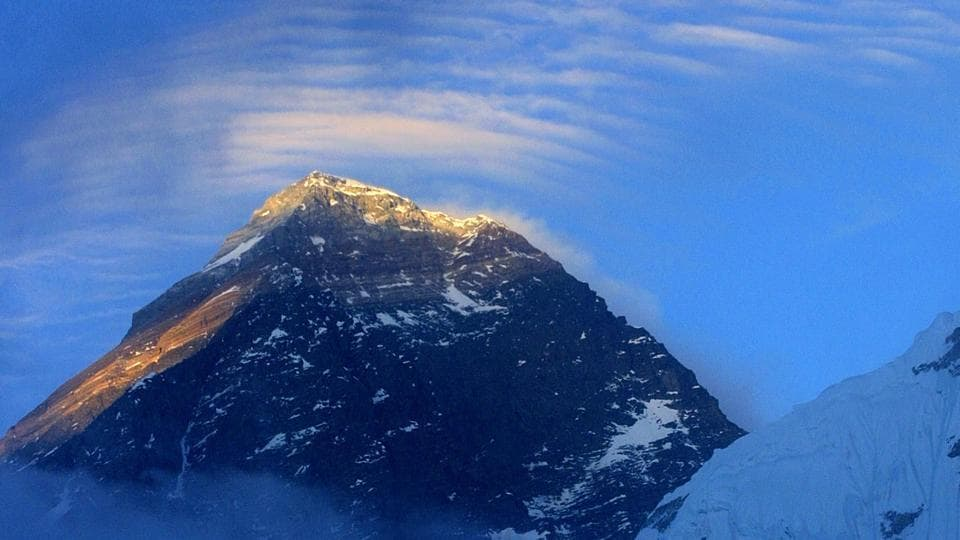 The world's highest mountain has been in the news recently for several reasons. Two Indian women broke their own climbing records while three mountaineers including an Indian have died on the mountain in the past week and news has now emerged that the historic Hillary Step on the south-east ridge on the mountain has collapsed, potentially making it more dangerous to climb in the final stages of attempting the summit. A record number of 371 climbing permits have been issued for this season due to pent up demand in the aftermath of the 2015 Nepal earthquake and the tragic death of 16 people in a 2014 avalanche disaster which limited climbing on the mountain. (GURINDER OSAN/AP)