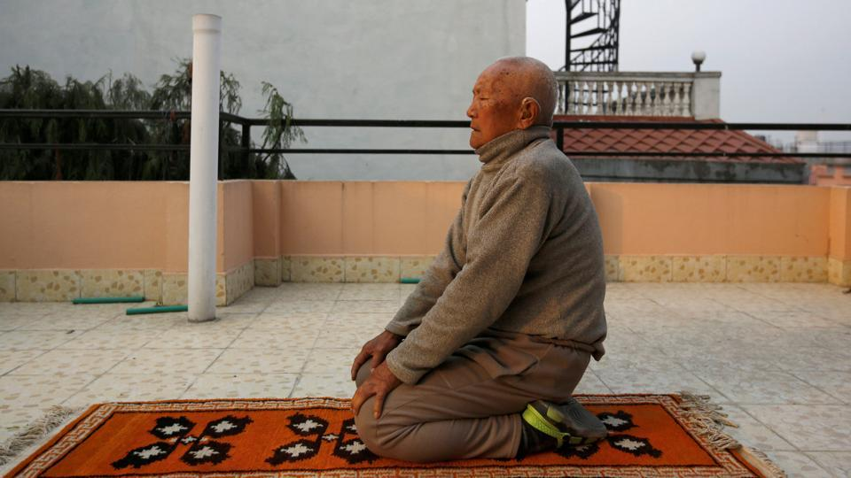 In this file photo from April 2017, Nepali mountaineer Min Bahadur Sherchan, 85, performs yoga in Kathmandu. Serchan died at base camp in early May while attempting to climb Everest to try and retain his earlier title of the oldest person to conquer the world's highest mountain. (REUTERS)
