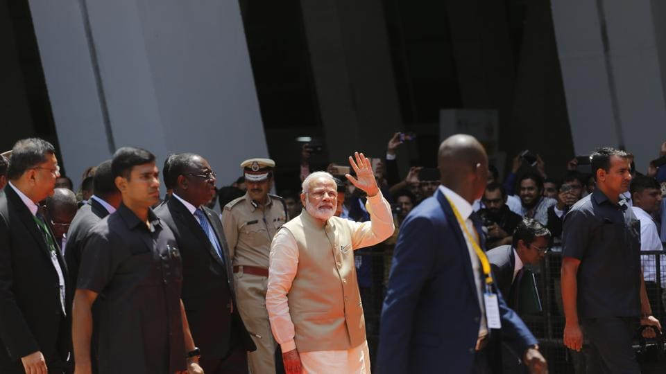 Indian Prime Minister Narendra Modi, waves to people as he leaves after inaugurating the annual meeting of the African Development Bank in Gandhinagar, India, Tuesday, May 23, 2017.