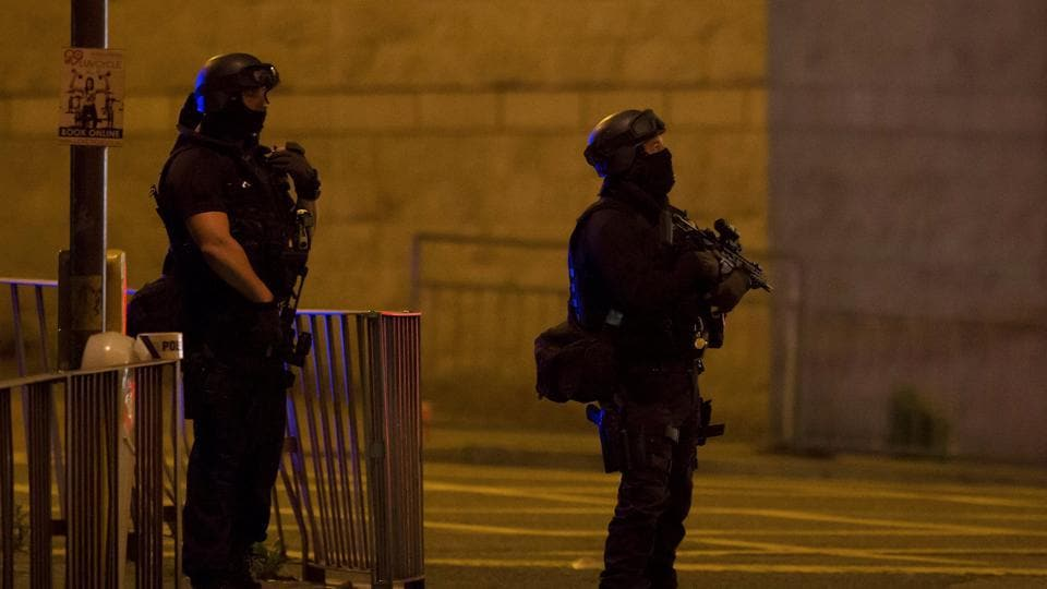 Armed police officers stand outside the Manchester Arena, where US singer Ariana Grande had been performing in Manchester, northern England, Britain.
