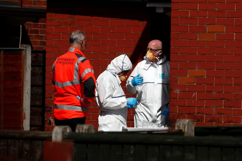 Police investigators work at residential property in south Manchester.  (Stefan Wermuth/REUTERS)