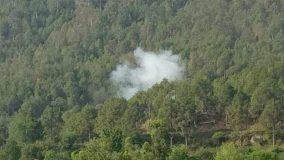 Smoke billows out from a forest area after mortar shells were fired by the Pakistani Army in Naushera in Kashmir.