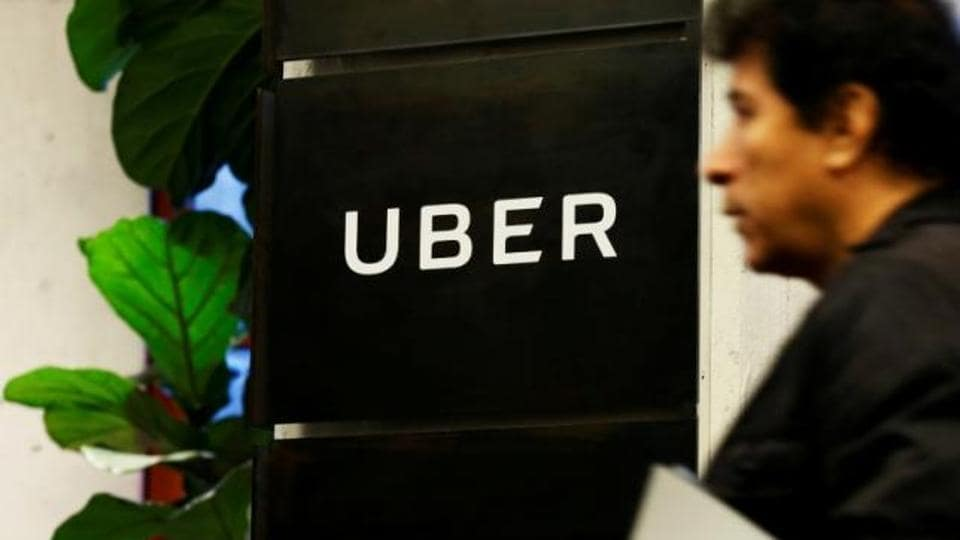 A man exits the Uber offices in Queens, New York.