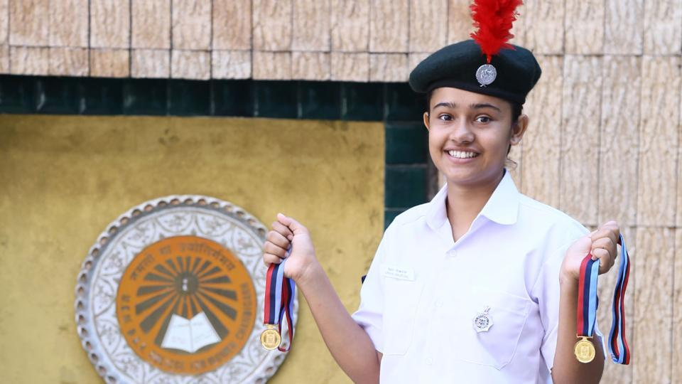 This youngster, Priya Paudyal, won widespread admiration when she was adjudged the best naval NCC cadet in the Republic Day Camp 2017.  (HT Photo)