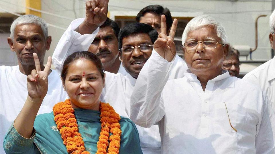 On May 16, the IT Department raided 22 places in and around Delhi in connection with the alleged benami property deals involving Lalu Prasad and his children .