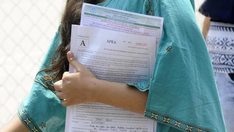 tudents come out after appearing for the NEET medical exam in Noida.