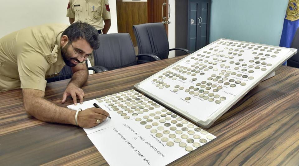 Officials showing the seized coins at Customs House in Amritsar on Tuesday.