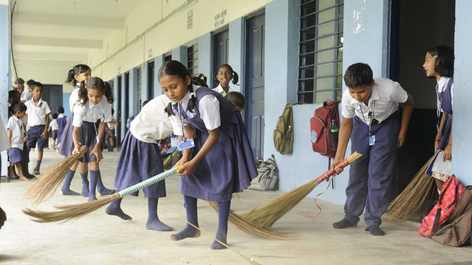 The RSS is spreading across north Bengal through a network of schools and shakhas. Seen here, students clean a school before prayers.