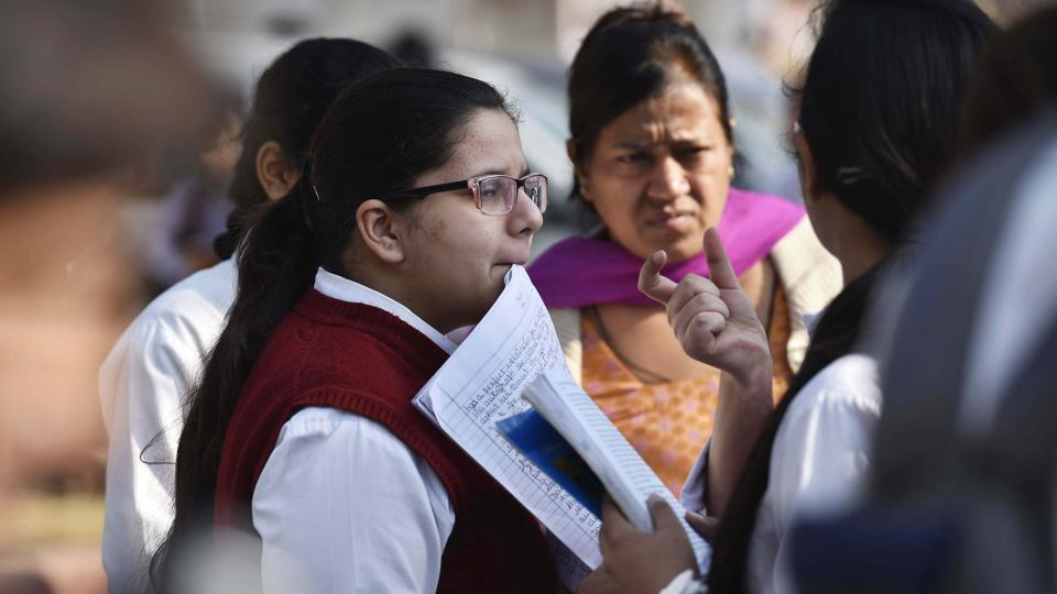 Students at an exam centre before taking the CBSE Class 12 exam.