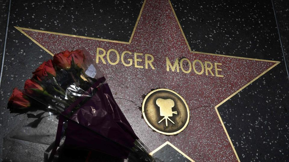 Flowers are placed on the Hollywood Walk of Fame star of actor Roger Moore in Hollywood, California. (Mark RALSTON / AFP)