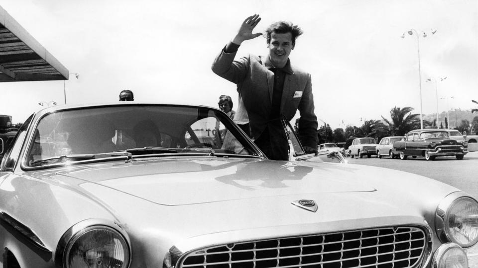 British actor Roger Moore poses with a Volvo P1800 on June 9, 1965 in Nice, southern France. The vehicle was featured as the main car driven by Moore in the hit television series 'The Saint' which aired from 1962-1969. (Susan RAGAN / AFP)