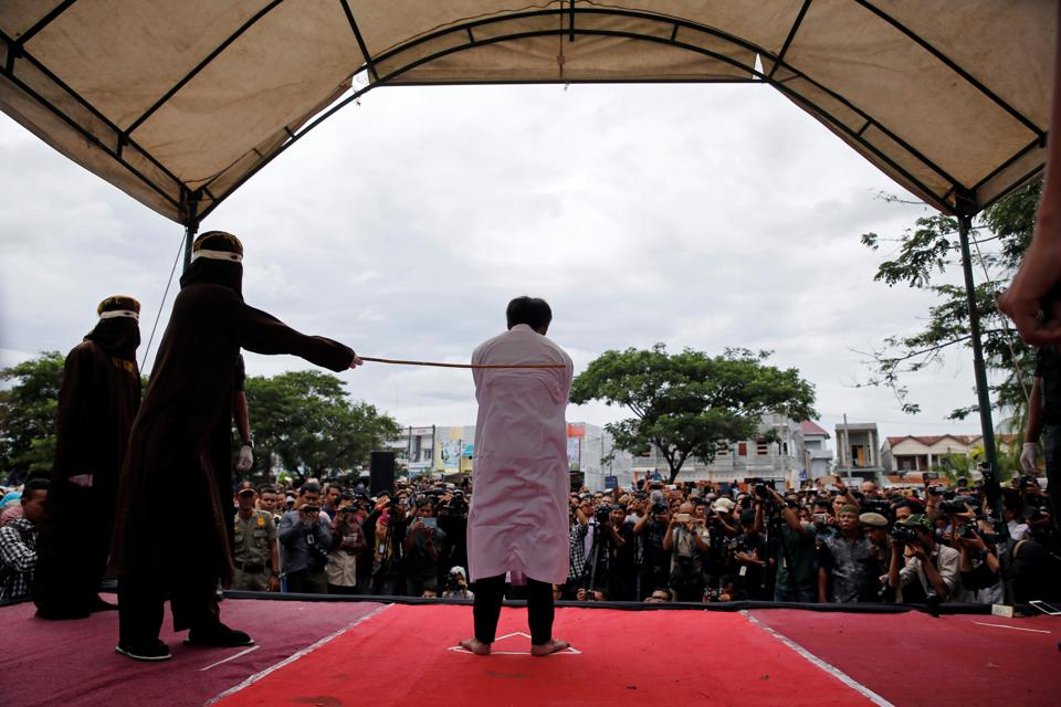 An Indonesian man is publicly caned for having gay sex in Banda Aceh, Aceh province, Indonesia. Aceh was granted special rights to introduce its own conservative Sharia laws more than a decade ago and strict laws against homosexuality came into effect in recent years. Gay sex is not illegal in most of Indonesia but it is in Aceh, where perhaps for the first time gay men have been caned under Islamic law in the province.  (REUTERS)