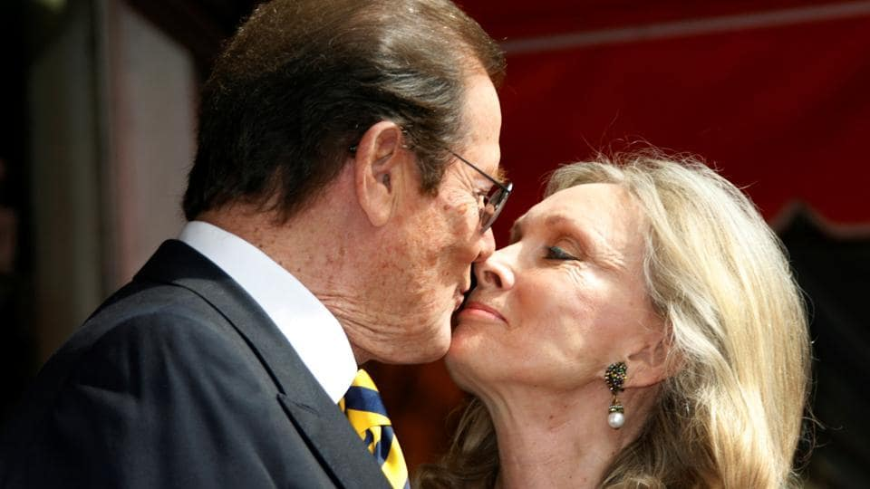 British actor Roger Moore kisses his wife Kristina during ceremonies unveiling his star on the Hollywood Walk of Fame in Hollywood, California October 11, 2007. Moore was married four times and is survived by two sons and a daughter. (Fred Prouser / REUTERS)
