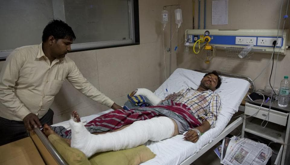 A relative attends to Rajesh Kumar, 28, who was attacked by a group of people while returning from a rally, at a government hospital in Meerut.Dalits were attacked while they were returning from a rally led by their leader Mayawati in Saharanpur, a town in Uttar Pradesh state.