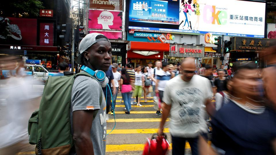 Solomon Nyassi poses on a street at Tsim Sha Tsui. Medard Koya said the team aimed to promote solidarity and provide hope for other asylum seekers facing an uncertain future far from home. (Bobby Yip/REUTERS)