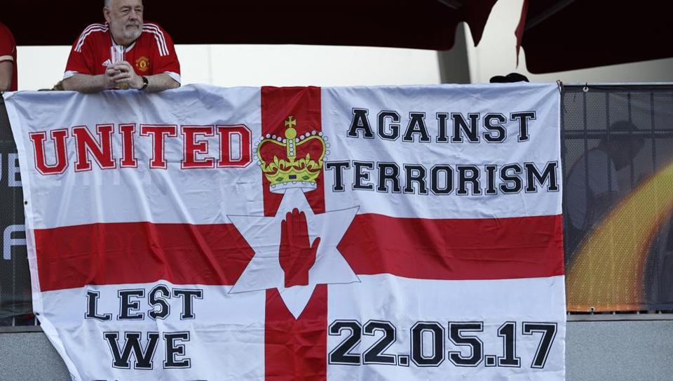 Manchester United fans display a banner in reference to the terror attack in Manchester before their Europa League final against Ajax.