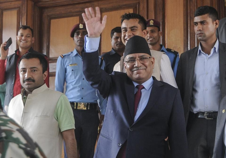 Nepalese Prime Minister Pushpa Kamal Dahal, also known as Prachanda, waves as he leaves after announcing his resignation during an address to the nation in Kathmandu on Wednesday.