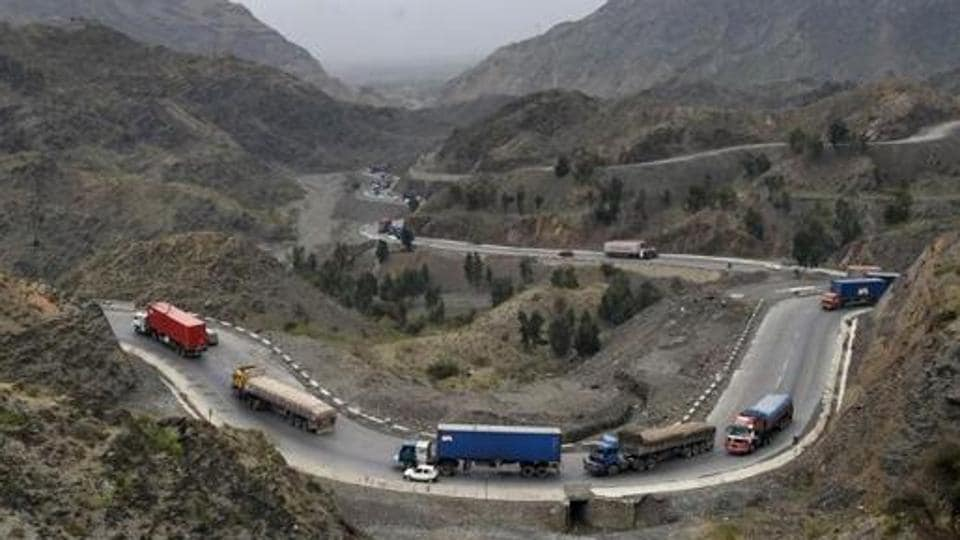 Trucks and other vehicles travel in the mountainous area near Torkham, close to the Pakistan-Afghanistan border.