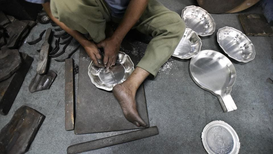 Using the craft of 'chitai', sheets of silver are shaped and embossed to create the desired objects.  (Burhaan Kinu/HT PHOTO)